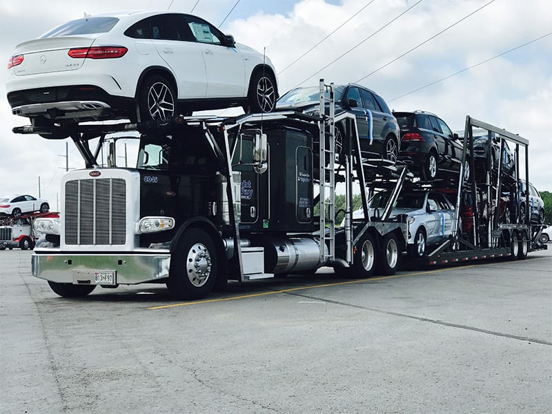 Auto transport truck loaded to capacity. Let Super Dispatch help your Auto transport business run at full capacity.