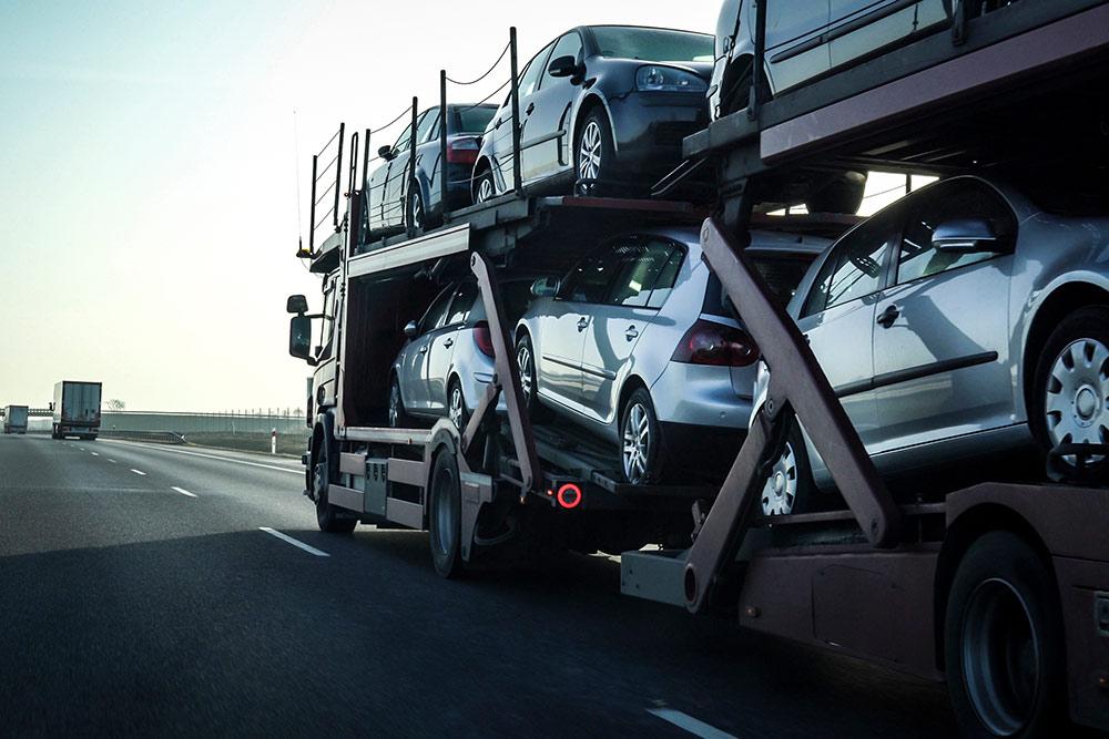 Semi hauling vehicles down highway road